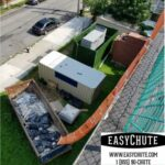Easy Chute on a construction roofing job removing roofing trash, with our roofing chute.